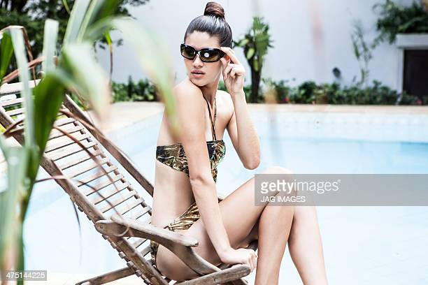 Young woman at hotel pool looking around
