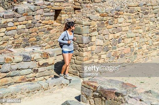 Young woman at Inca Ruins in Peru - Ollantaytambo Fortress : Stock Photo