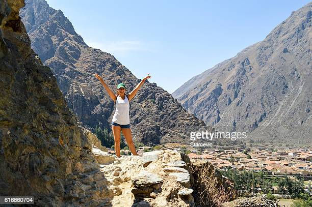 Young woman at Inca Ruins in Peru - Ollantaytambo Fortress