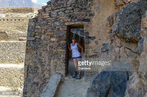 Young woman at Inca Ruins in Peru - Ollantaytambo Fortress : Stock Photo