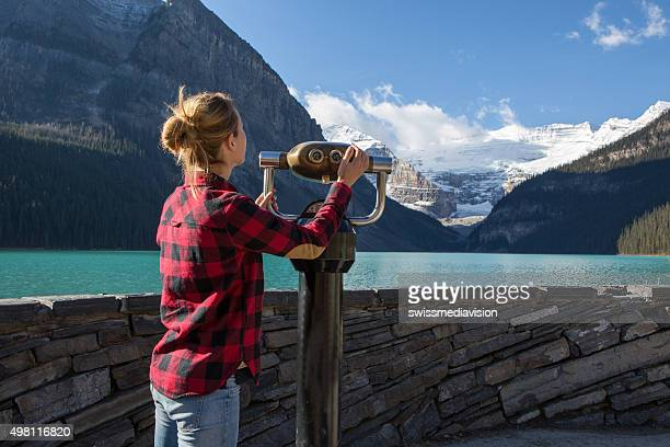 Young woman at lake Louise looking at view from viewfinder