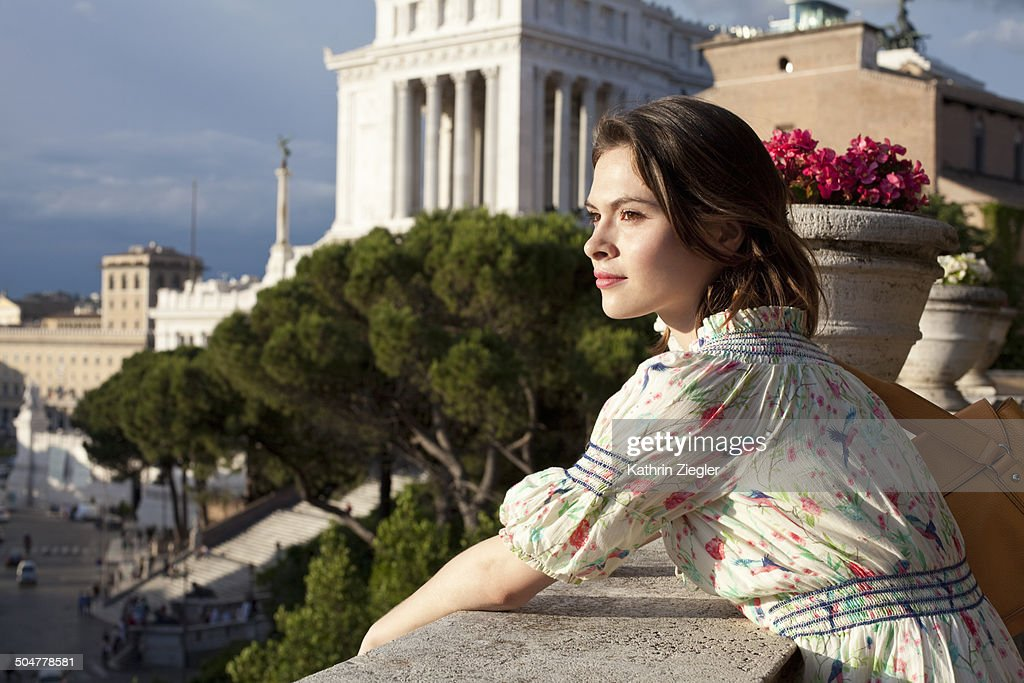young woman at look-out, enjoying view of Rome