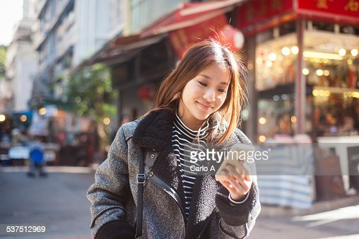Young woman at mobile phone
