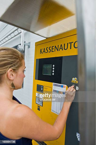 Young woman at pay machine