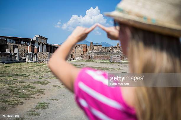 Young woman at Pompeii with Mount Vesuvius
