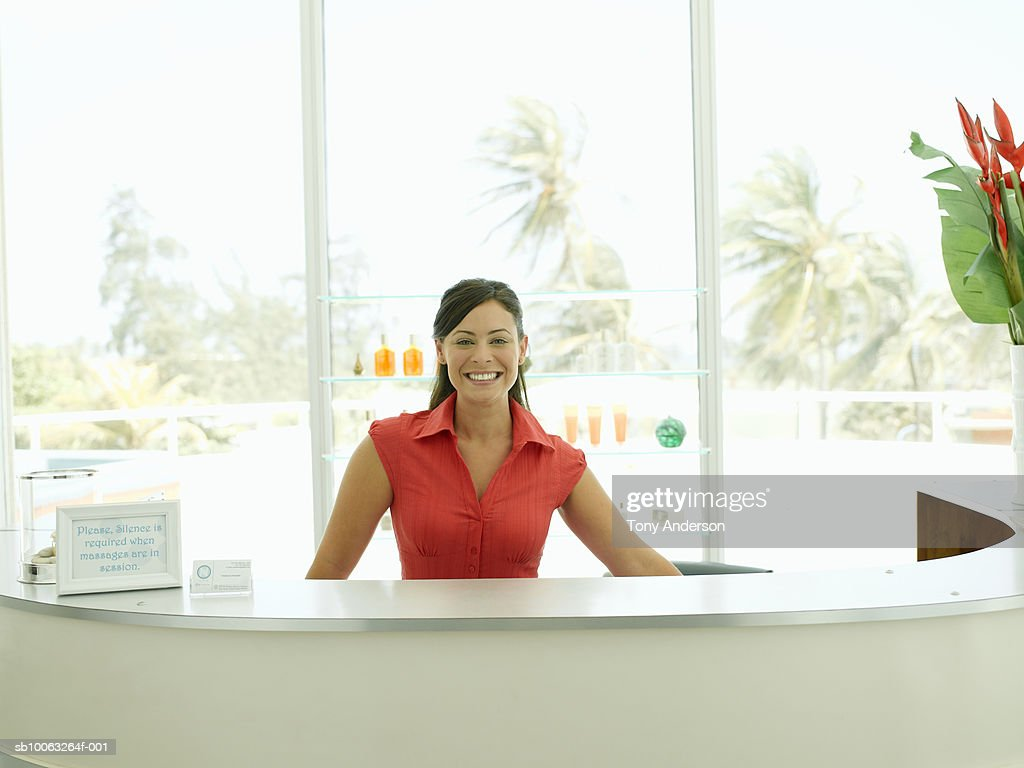 Young woman at reception in health farm, smiling, portrait