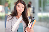 Young Woman at school with school books