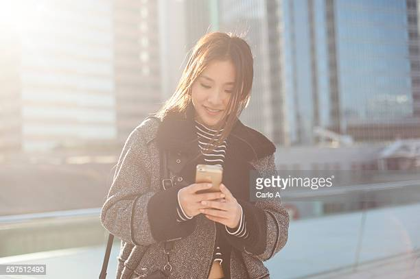 Young woman at smartphone.