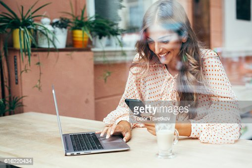 Young woman at the cafe : Stock Photo
