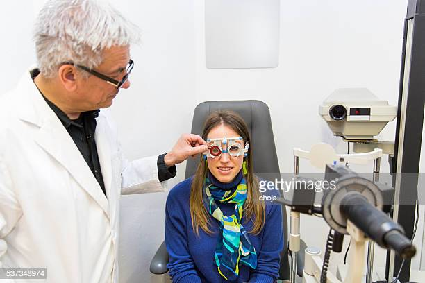 Young woman at the optometrist,doctor is checking her vision