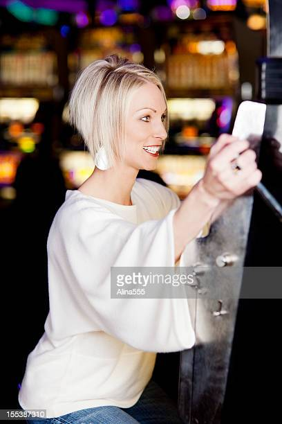 Young woman at the slot machine