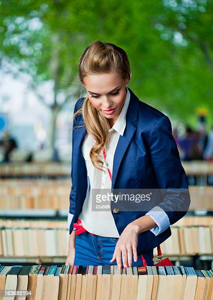 Young woman at the street book market
