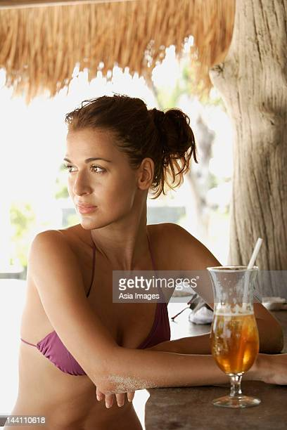 young woman at tropical bar