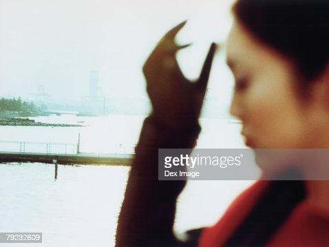 Young woman at waterfront, close up : Stock Photo