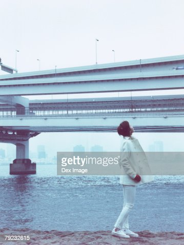 Young woman at waterfront, portrait : Stock Photo