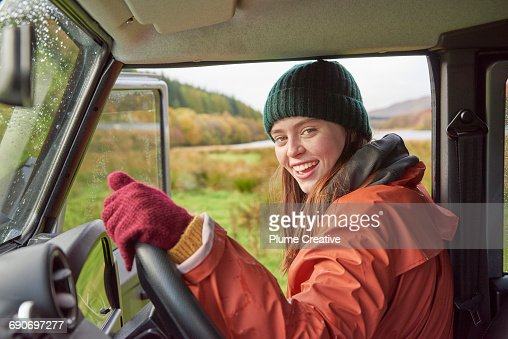 Young woman at wheel of 4x4