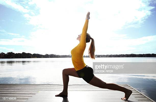 Young woman athlete doing yoga stretching