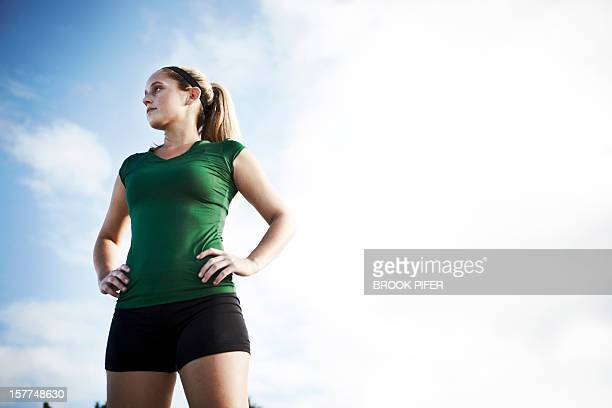 Young woman athlete looking off into distance