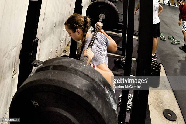 Young Woman Backsquatting Heavy Weight