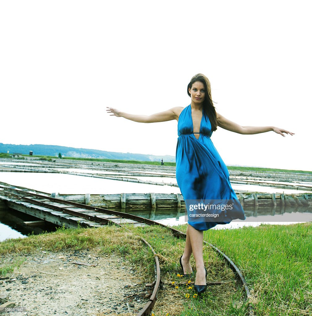 Young Woman Balancing and Walking on Railway Tracks : Stock Photo