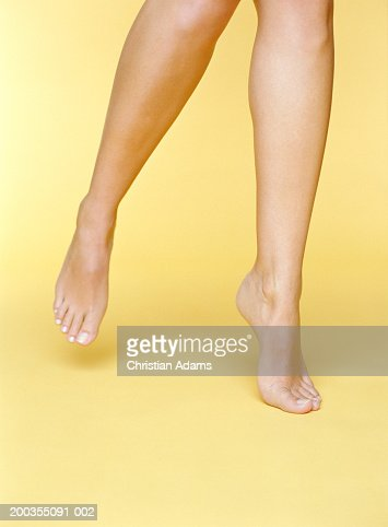 Young woman balancing on toes of one foot, close-up