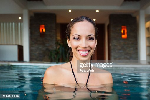 Young woman bathing in swimming pool : Bildbanksbilder