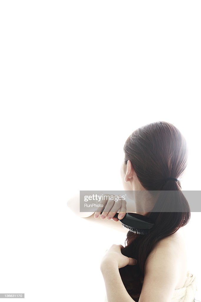 young woman beauty,brushing hair