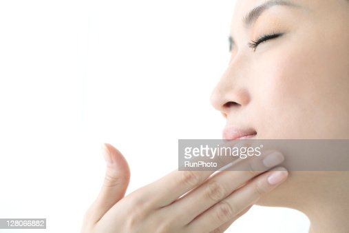 young woman beauty,woman touching her face