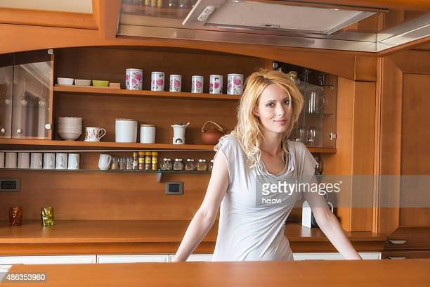 Young woman behing kitchen counter