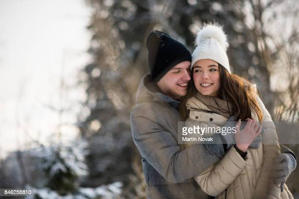 Young woman being hugged by her man