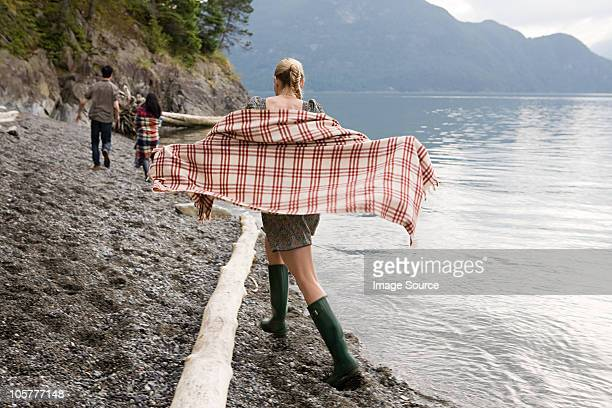 Young woman beside lake with checked shawl