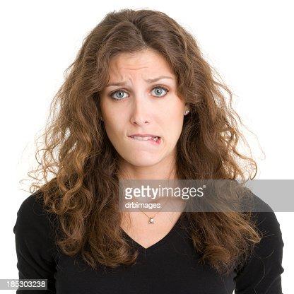 Young Woman Biting Lip
