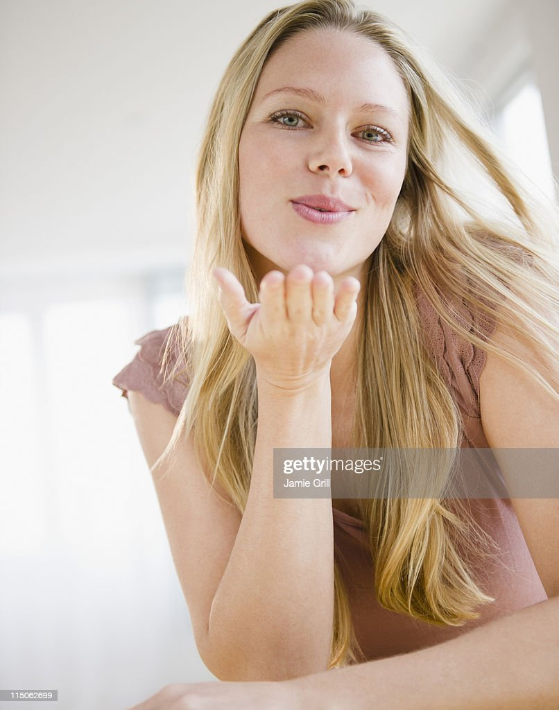 Young woman blowing a kiss : Stock Photo