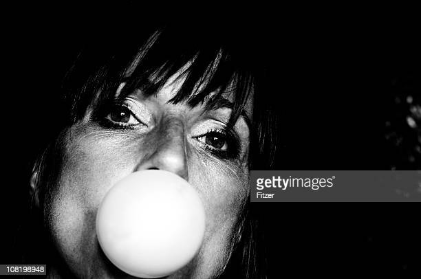 Young Woman Blowing Bubble with Gum, Black and White