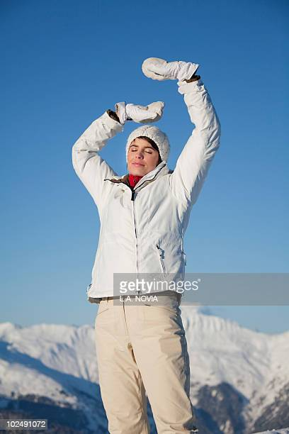 Young woman breathing fresh air