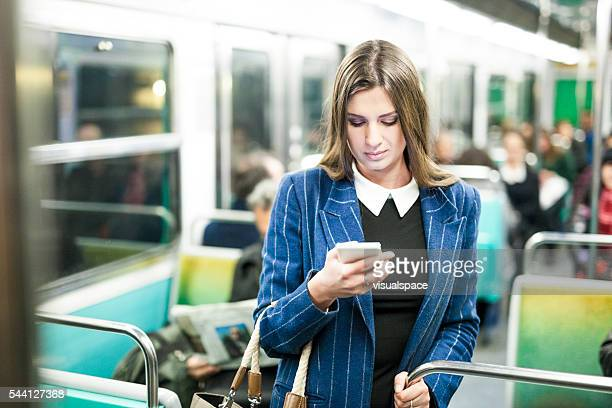Young Woman Browsing Social Media While Riding Subway