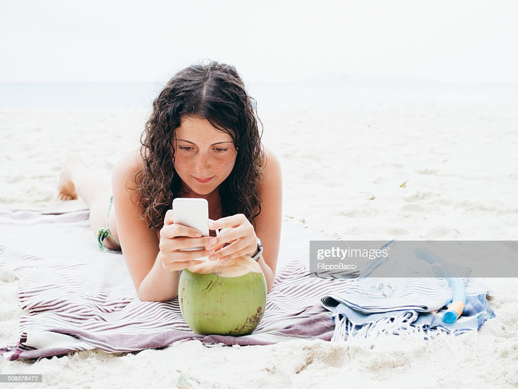 Young Woman Browsing The Net During Vacations : Stock Photo