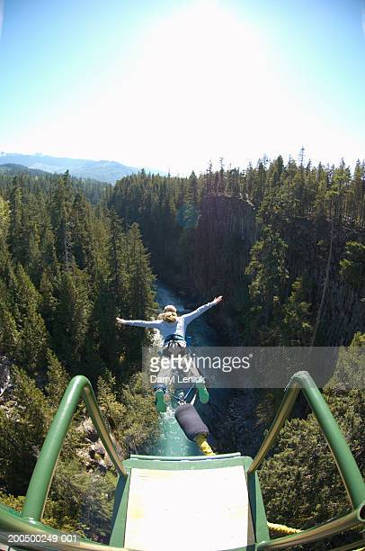 Young woman bungee jumping, elevated view, (wide angle)