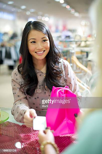 young woman buying goods