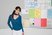 Young woman by noticeboard