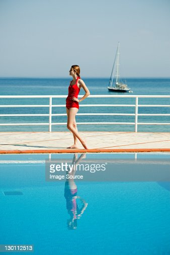 Young woman by swimming pool, portrait : Stock Photo