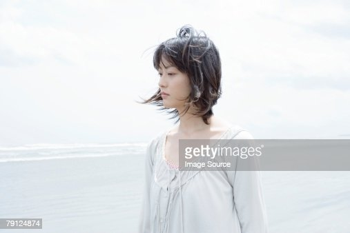 Young woman by the sea : Stock Photo