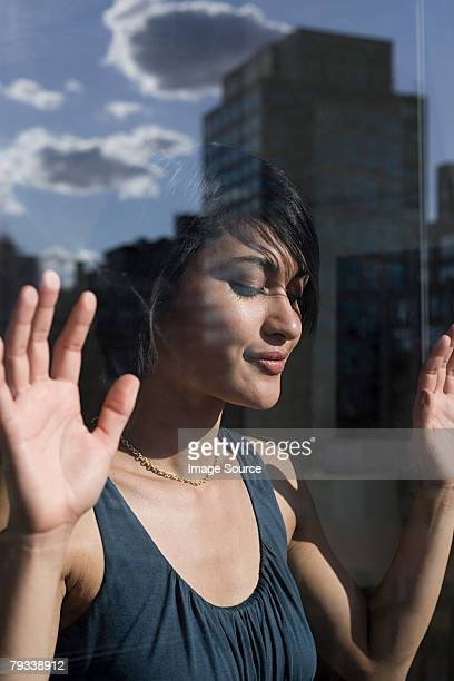 Young woman by window