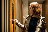 young woman calling elevator