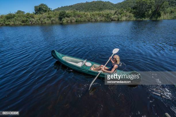 Young woman canoeing on the river