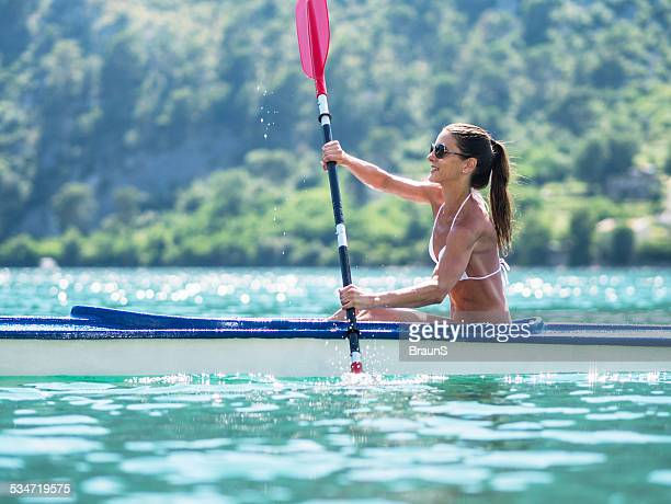 Young woman canoeing.