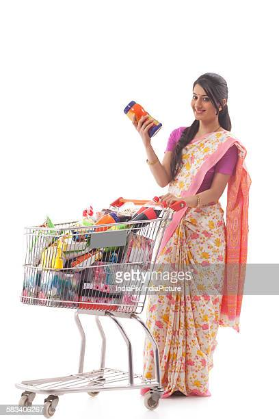 Young woman carrying a shopping cart