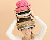 Young Woman Carrying Hat