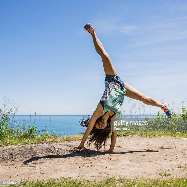 Young woman cartwheeling