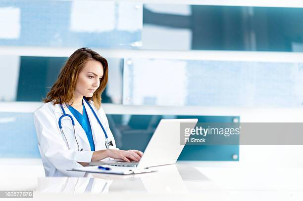 Young Woman Caucasian Doctor Nurse in Office